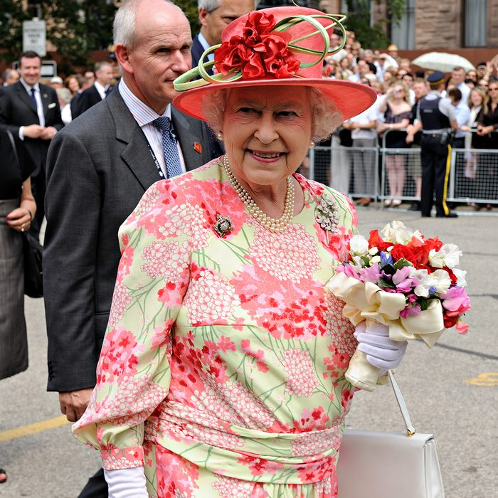 Thousands of people packed University Avenue and the grounds of Queen's Park to catch a glimpse of the Queen and the Duke of Edinburgh in Toronto