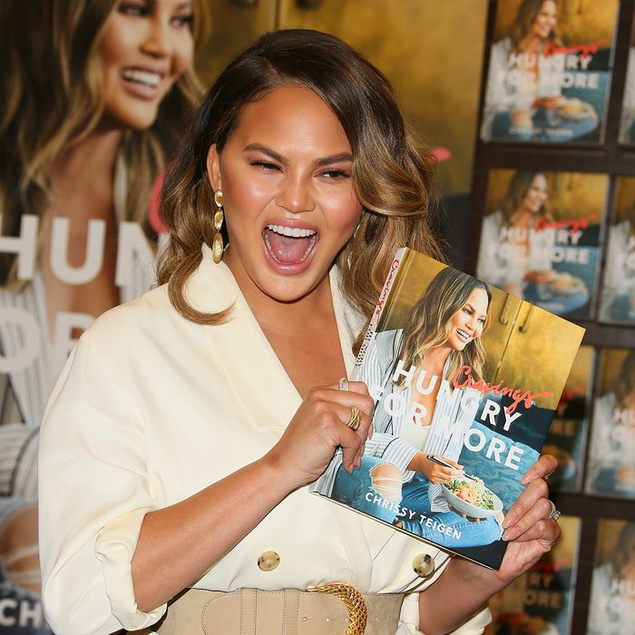 """LOS ANGELES, CA - SEPTEMBER 26: Chrissy Teigen signs copies of her new book """"Cravings: Hungry For More"""" on September 26, 2018 in Los Angeles, California. (Photo by JB Lacroix/Getty Images)"""