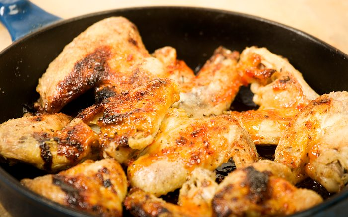 tasty roast chicken wings with spicy sauce