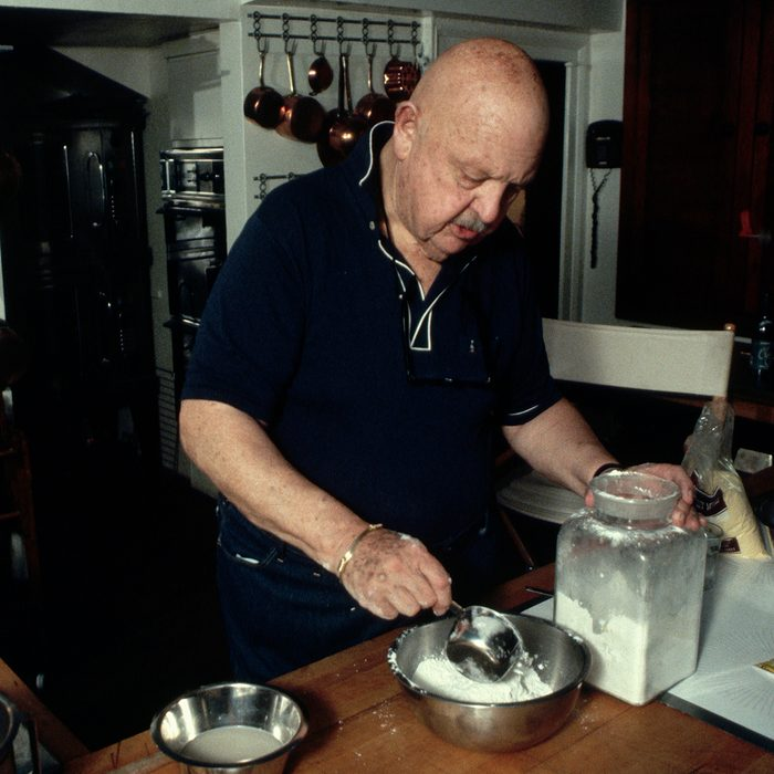 James Beard, a famous food critic, prepares a meal in his kitchen at home. (Photo by �� Jacques M. Chenet/CORBIS/Corbis via Getty Images)