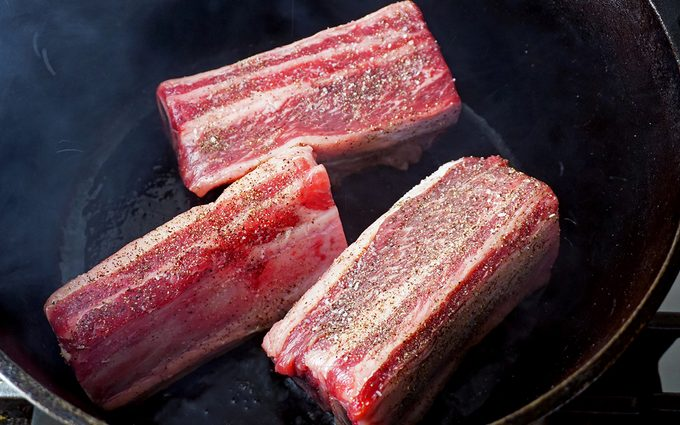 Short ribs being seared 1