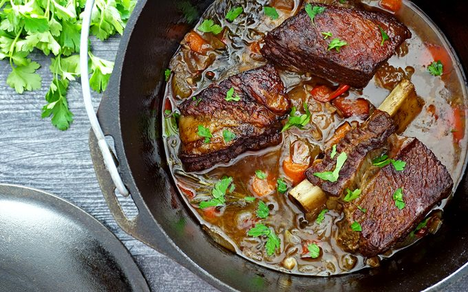 Dutch oven short ribs in cooking liquid after braising in the oven 1
