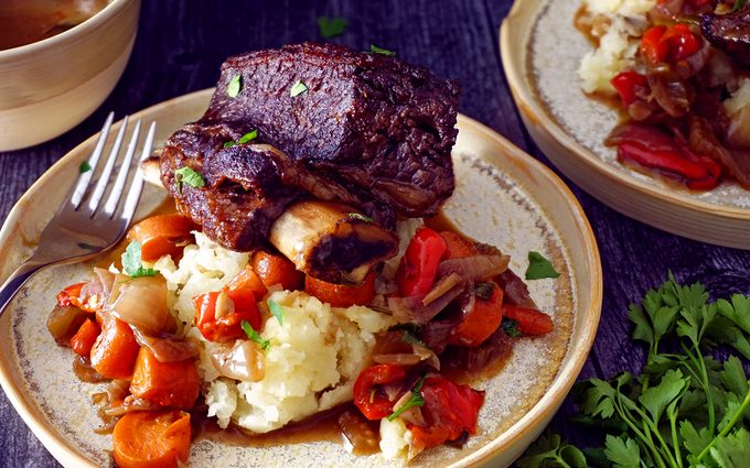braised Dutch oven short ribs with gravy on top