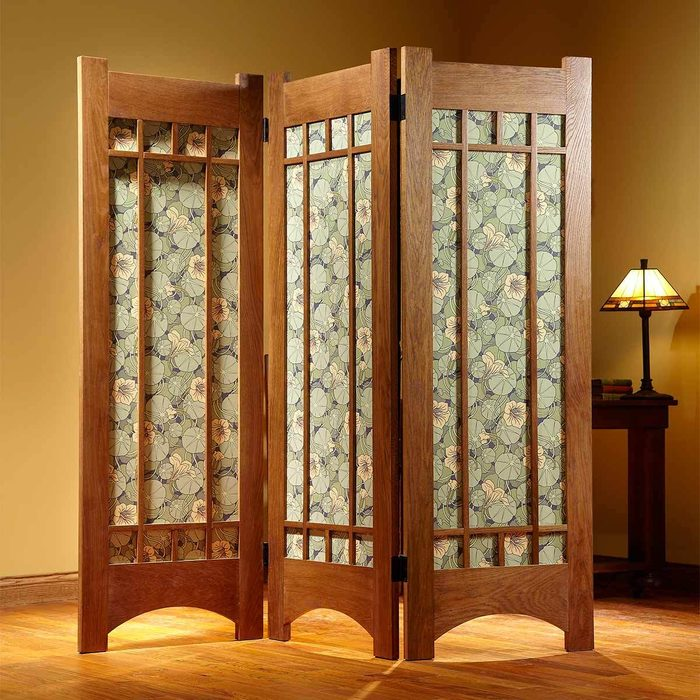 Room divider with wallpaper detail