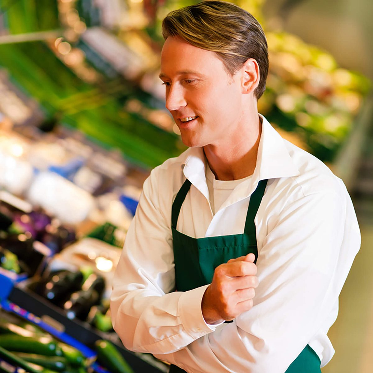 Shop assistant in a supermarket at the vegetable shelf checking the stuff for sale; Shutterstock ID 63574951; Job: RD