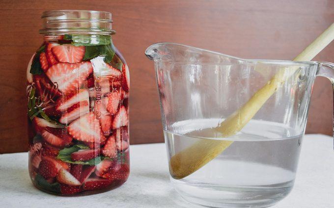 Jar with pitcher of vodka