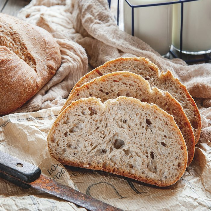 Delicious homemade sourdough rye bread on a plate and milk. Homemade baking.
