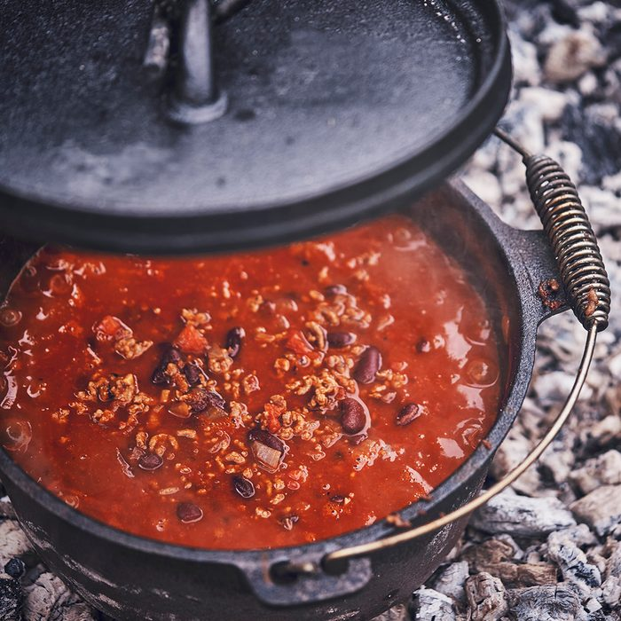 Cooking Chili Con Carne in Dutch Oven over Logfire Outside