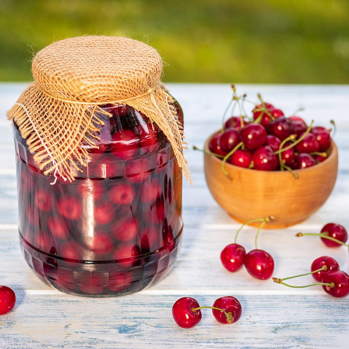 Homemade preserved organic fruits in glass jar. Selective focus, blurry background