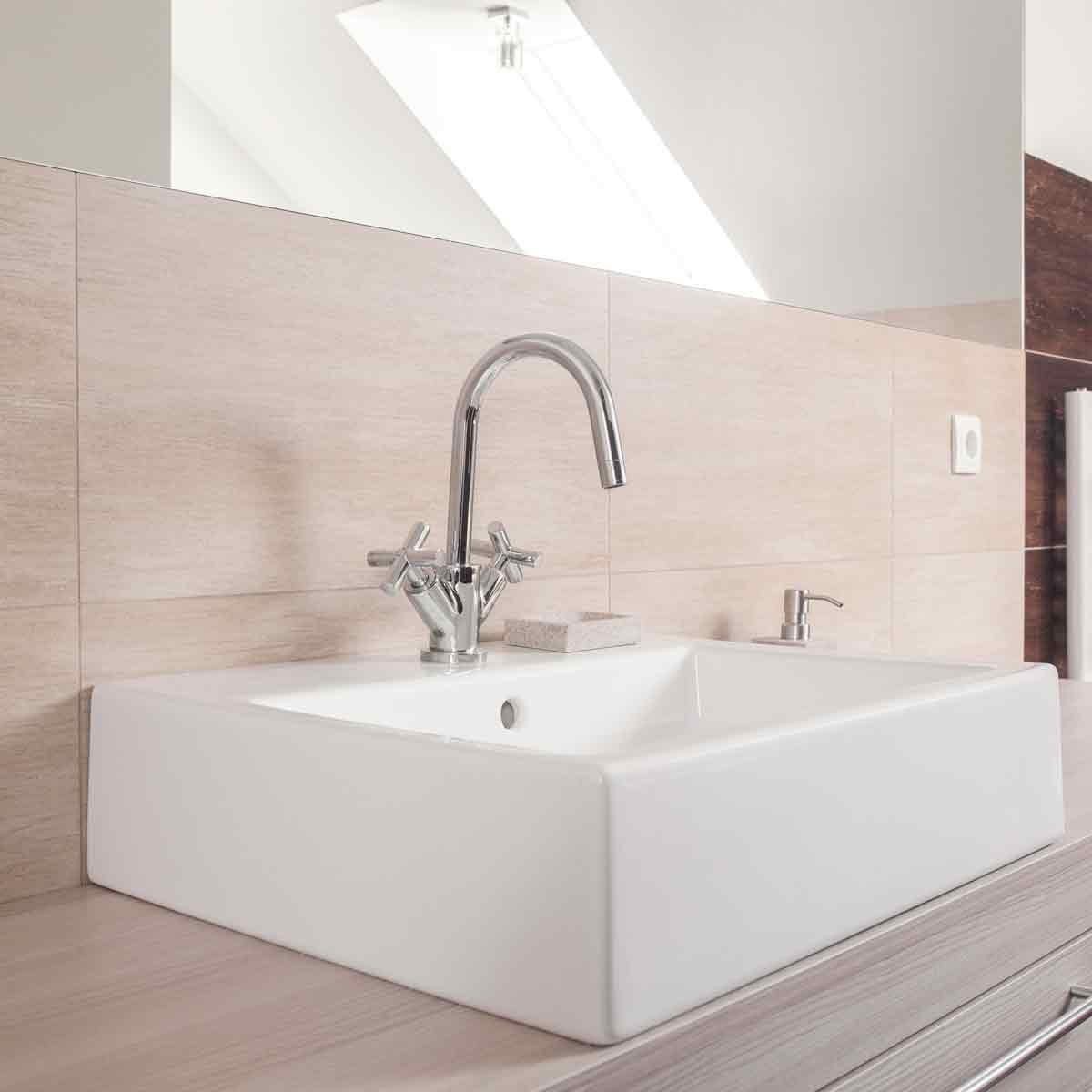 Neutral-colored-bathroom-with-Square-ceramic-sink-and-shiny-chrome-faucet