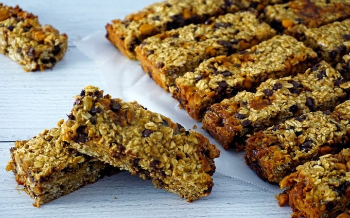 baked gluten-free granola bars scattered and stacked together