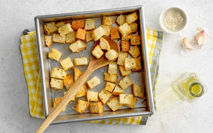 Homemade croutons in pan with ingredients.
