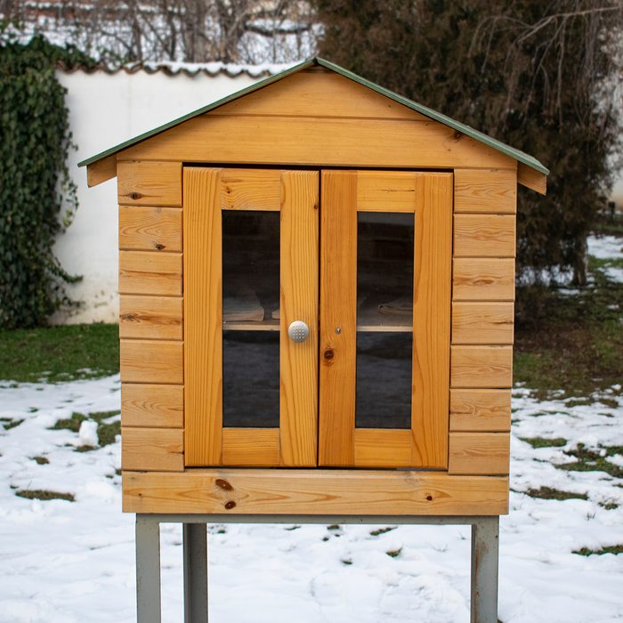 Giving free books exchange to others in the city. Small hand made wooden house with shelves for educational purpose.