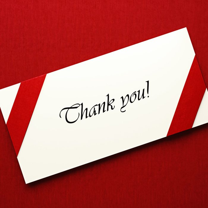 White thank you note on red background. Gratitude concept. Horizontal composition with copy space.