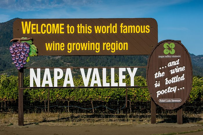 """RUTHERFORD, CA - OCTOBER 15: A large """"welcome"""" sign greets visitors to the Napa Valley as viewed on October 15, 2015, in Rutherford, California. Nearly 4 million domestic and international travelers visit Napa Valley each year, generating jobs in the arts, entertainment, recreation, food service, and lodging sectors. (Photo by George Rose/Getty Images)"""