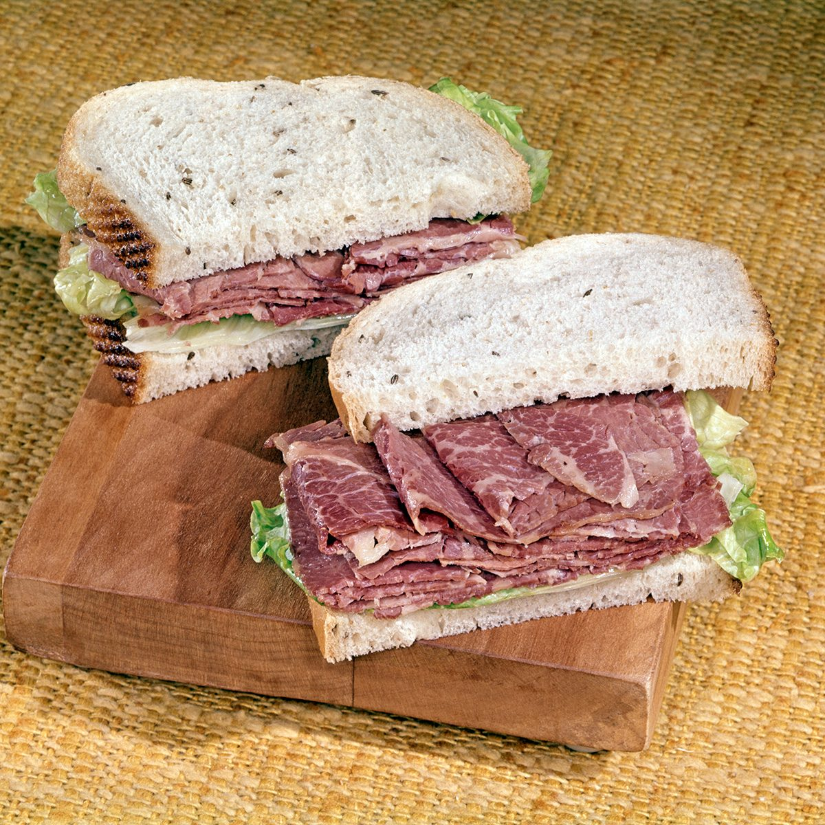 1960s CORNED BEEF SANDWICH ON RYE WITH LETTUCE (Photo by L. Fritz/ClassicStock/Getty Images)