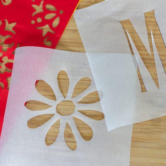 Bread stencils laid on a cutting board.