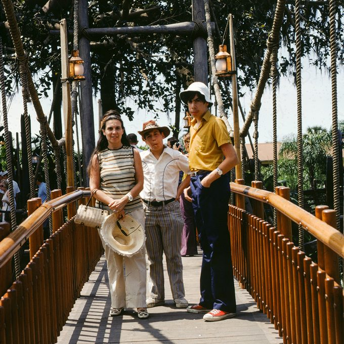 Three siblings stand on a rope bridge at Disney World amusement park, Orlando, Florida, 1975. (Photo via Smith Collection/Gado/Getty Images).