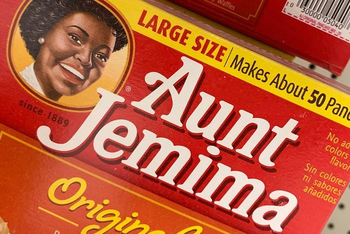 """Boxes of Aunt Jemima pancake mix are seen on a store shelf on June 17, 2020 in Washington,DC. - The Aunt Jemima brand of syrup and pancake mix will get a new name and image, Quaker Oats announced on June 17, 2020, saying that the company recognizes that """"Aunt Jemima's origins are based on a racial stereotype."""" The 130-year-old brand features a Black woman named Aunt Jemima, who was originally dressed as a minstrel character. Quaker, a subsidiary of PepsiCo, said removing the image and name is part of an effort by the company to make progress toward racial equality. (Photo by Eva HAMBACH / AFP) (Photo by EVA HAMBACH/AFP via Getty Images)"""