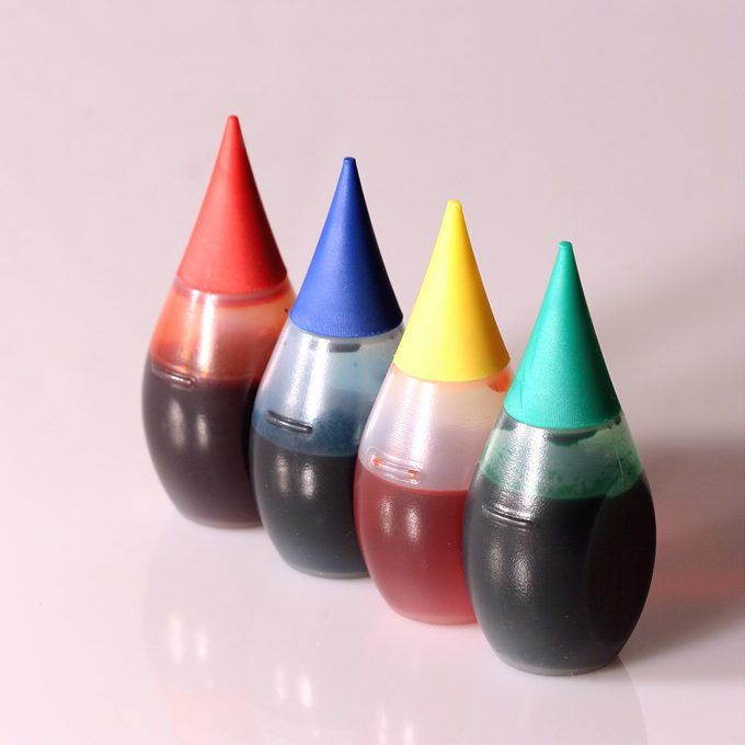 Four bottles of food coloring.