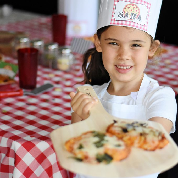 young girl with pizza for Pizza birthday party ideas