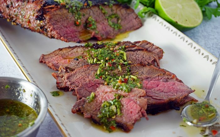 grilled and thinly sliced chimichurri marinated tri-tip steak perspective photo