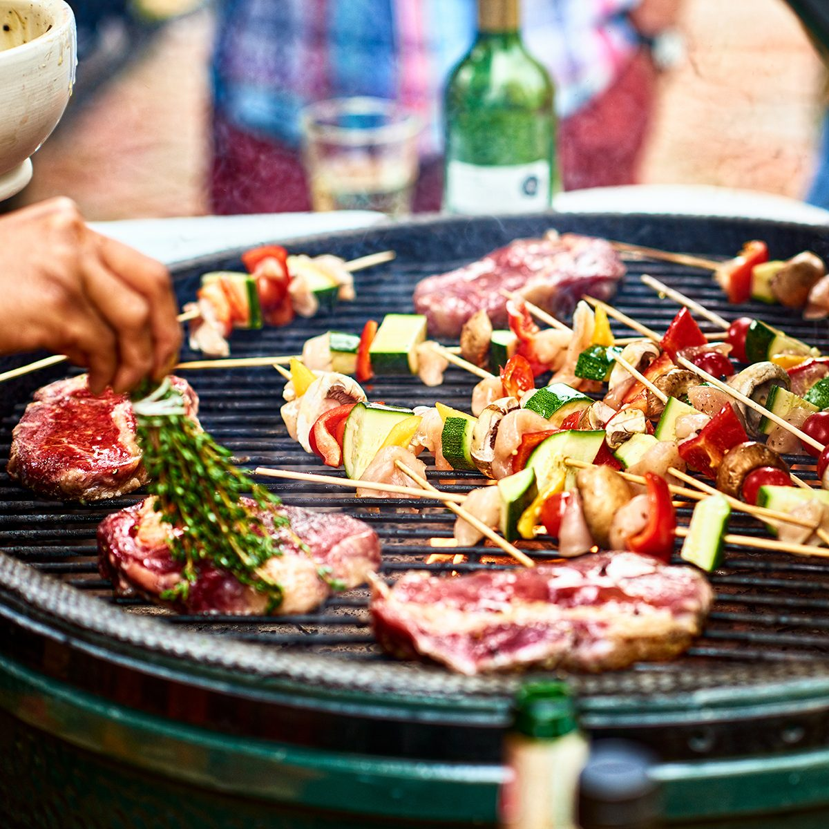 Fresh healthy food grilling on bbq, meat cooking with cubed mediterranean vegetables, sizzling, temptation, party