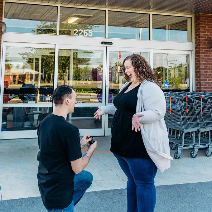 Patrick proposing in front of Aldi store