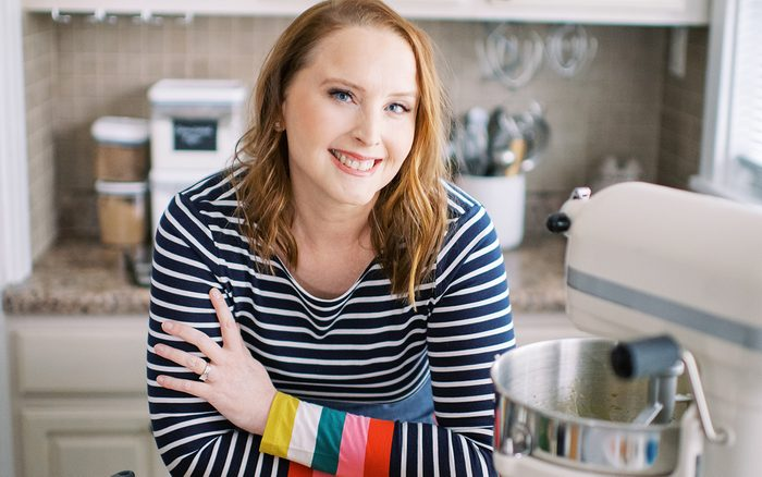 Woman leaning on counter and smiling