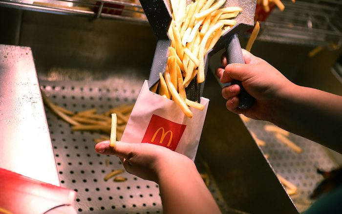 MIAMI, FL - APRIL 25: McDonald's crew member Samantha Medina prepares french fries as the McDonald's restaurant stock price reached record territory on April 25, 2017 in Miami, Florida. The company continues to beat expectations and credits changes to its menu and other new initiatives it has launched. (Photo by Joe Raedle/Getty Images)