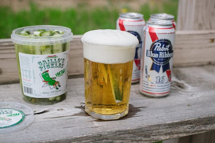 Pickle in glass of beer