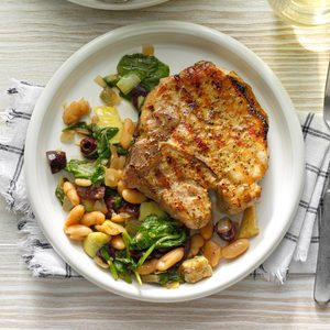 Dry-Rub Grilled Pork Chops over Cannellini Greens