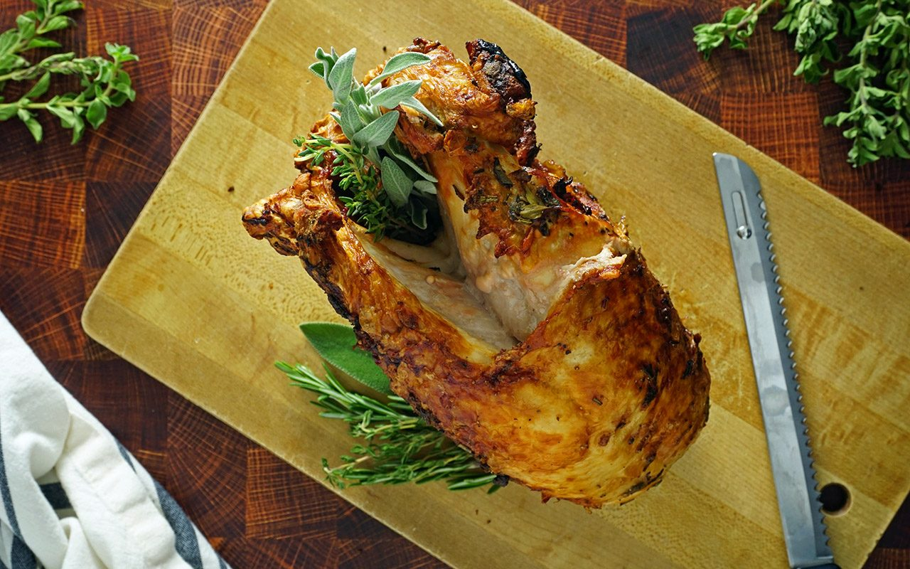 finished air fryer turkey breast resting on a carving board
