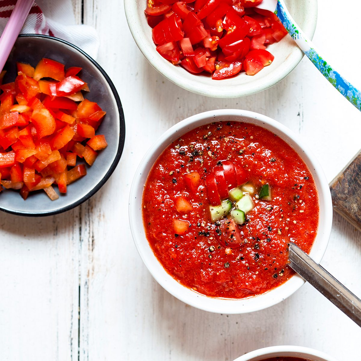 Bowl of Gazpacho with cucumber and bell pepper topping