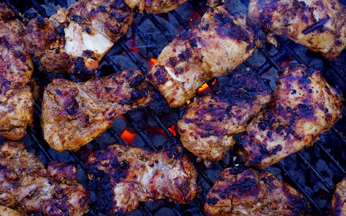 copycat chipotle chicken recipe being cooked on a charcoal grill