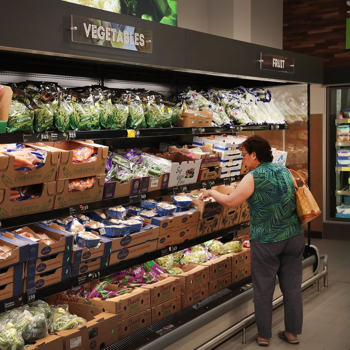 CHICAGO, IL - JUNE 12: Customers shop at an Aldi grocery store on June 12, 2017 in Chicago, Illinois. Aldi has announced plans to open 900 new stores in the United States in the next five years. The $3.4 billion capital investment would create 25,000 jobs and make the grocery chain the third largest in the nation behind Wal-Mart and Kroger. (Photo by Scott Olson/Getty Images)