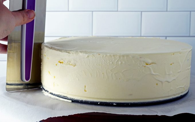 smoothing ice cream with cake smoother after removing springform pan outer ring