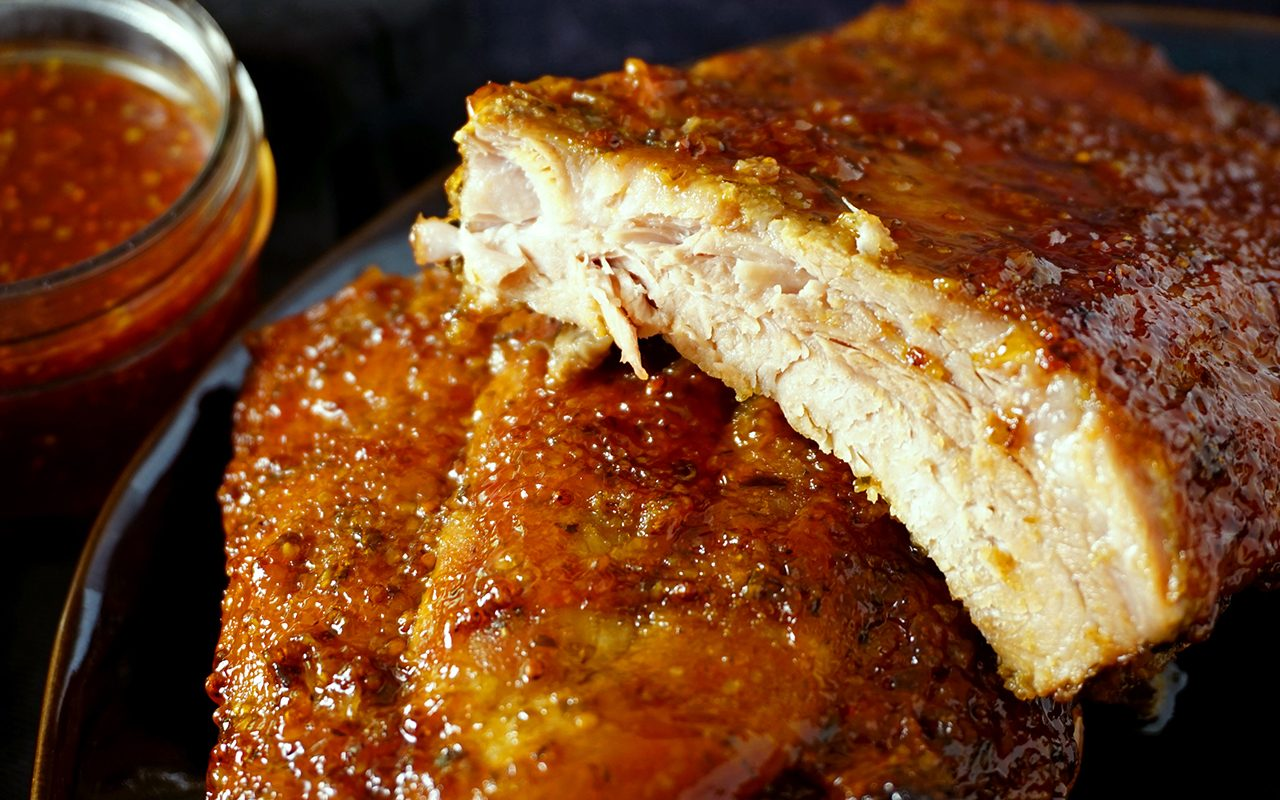 close-up view of juicy baby back ribs baked in the oven