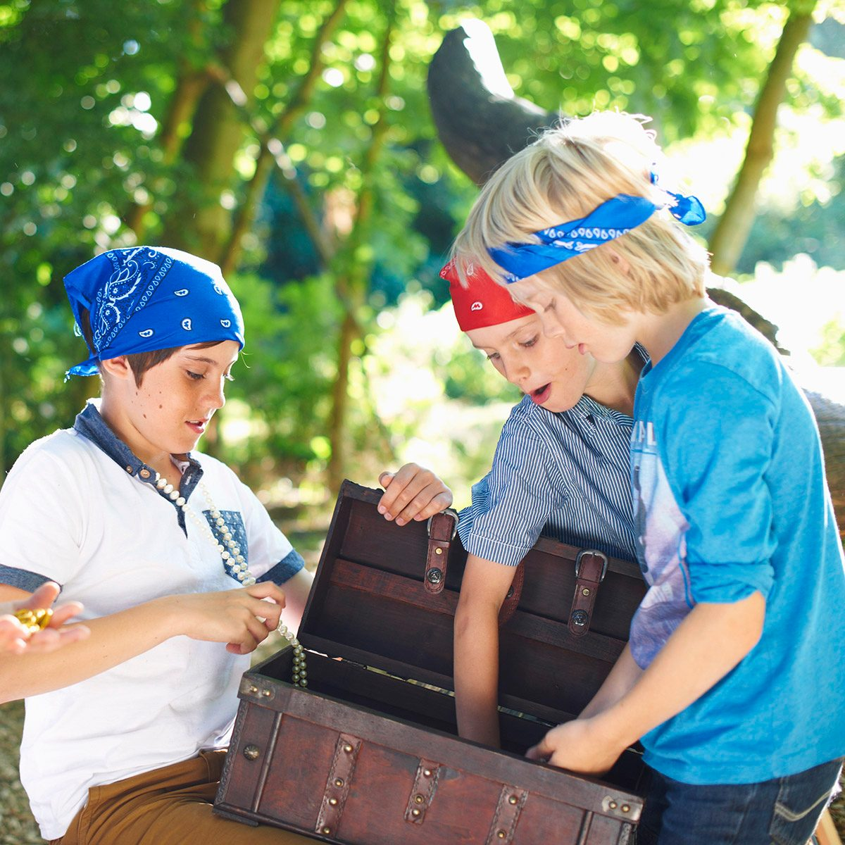 Young boys dressed as pirates with treasure chest