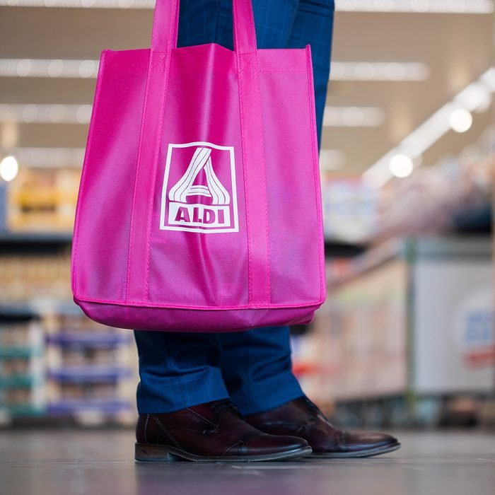 A man seen holding an ALDI North shopping bag with the logo in Herten, Germany, 04 April 2017. ALDI North has introduced a new branch conept. Photo: Rolf Vennenbernd/dpa | usage worldwide (Photo by Rolf Vennenbernd/picture alliance via Getty Images)