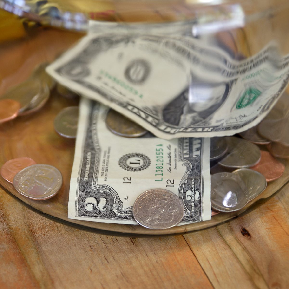 TAOS, NEW MEXICO - MAY 15, 2019: Money in a tip jar in a Taos, New Mexico, coffee shop includes a two dollar bill. (Photo by Robert Alexander/Getty Images)