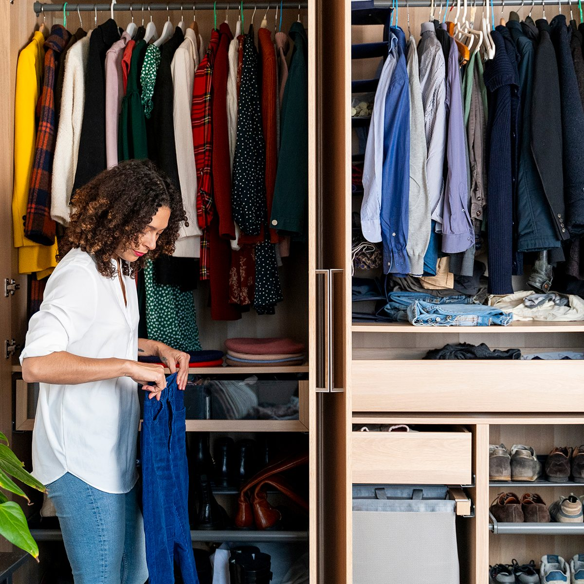 Italy, Tuscany, Florence, couple fixing the closet