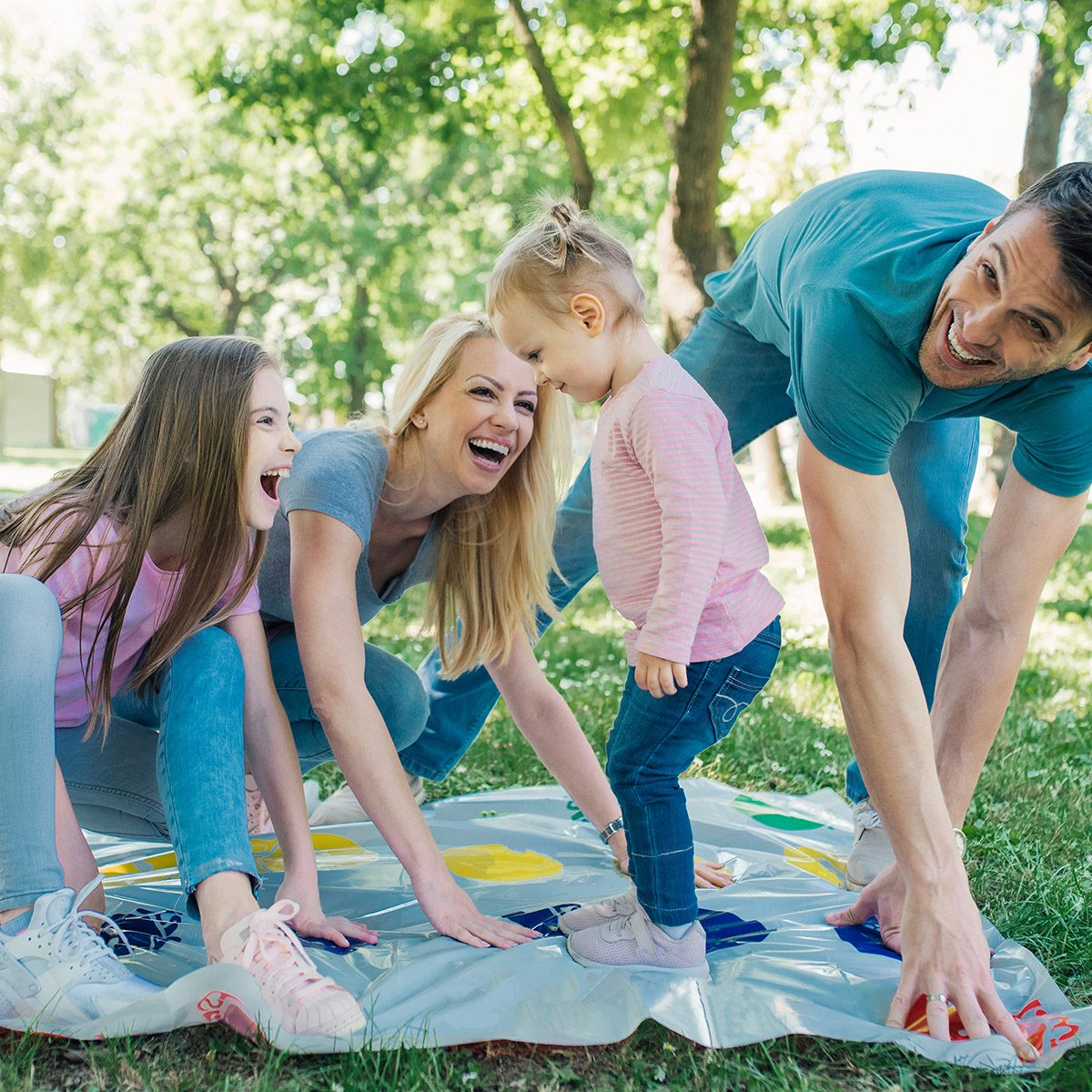 Family with two daughters having game day at the park
