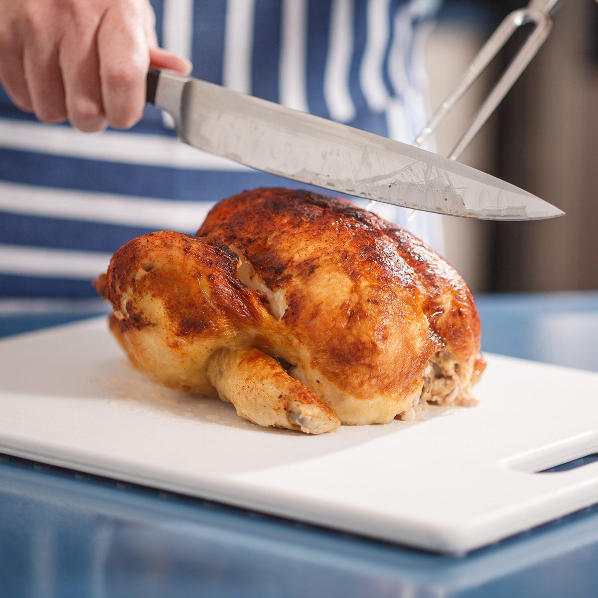 Slicing Chicken on cutting board