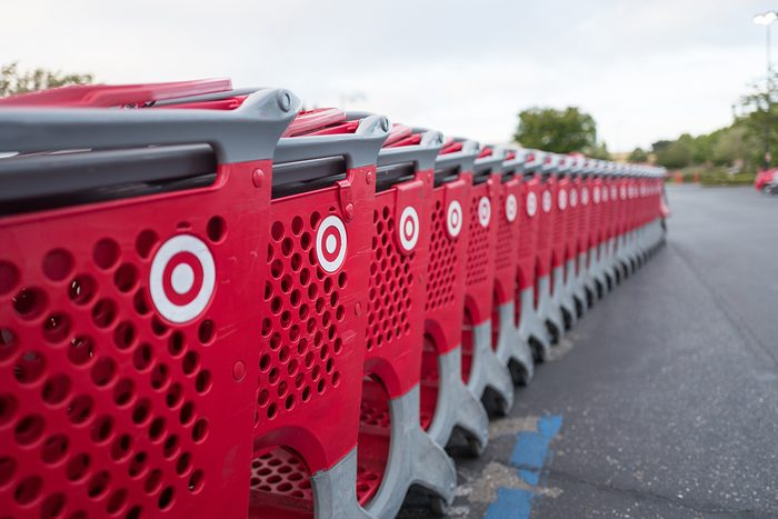 Selective-focus image of a long row of red Target shopping cars in the parking lot of a Target department store in Dublin, California, May 21, 2018. (Photo by Smith Collection/Gado/Getty Images) crop
