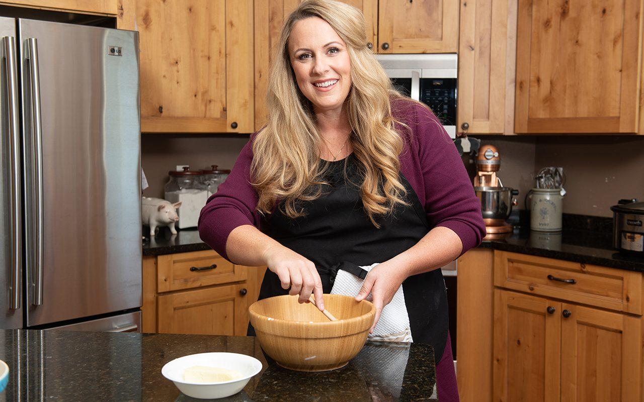 Cristen Clark mixing ingredients in a bowl
