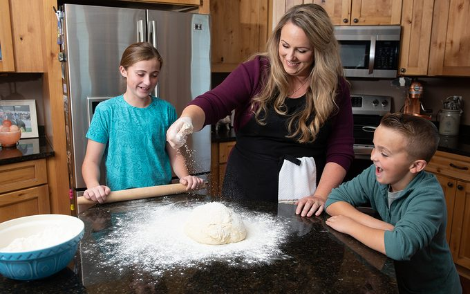 Cristen Clark cooking with her tow kids