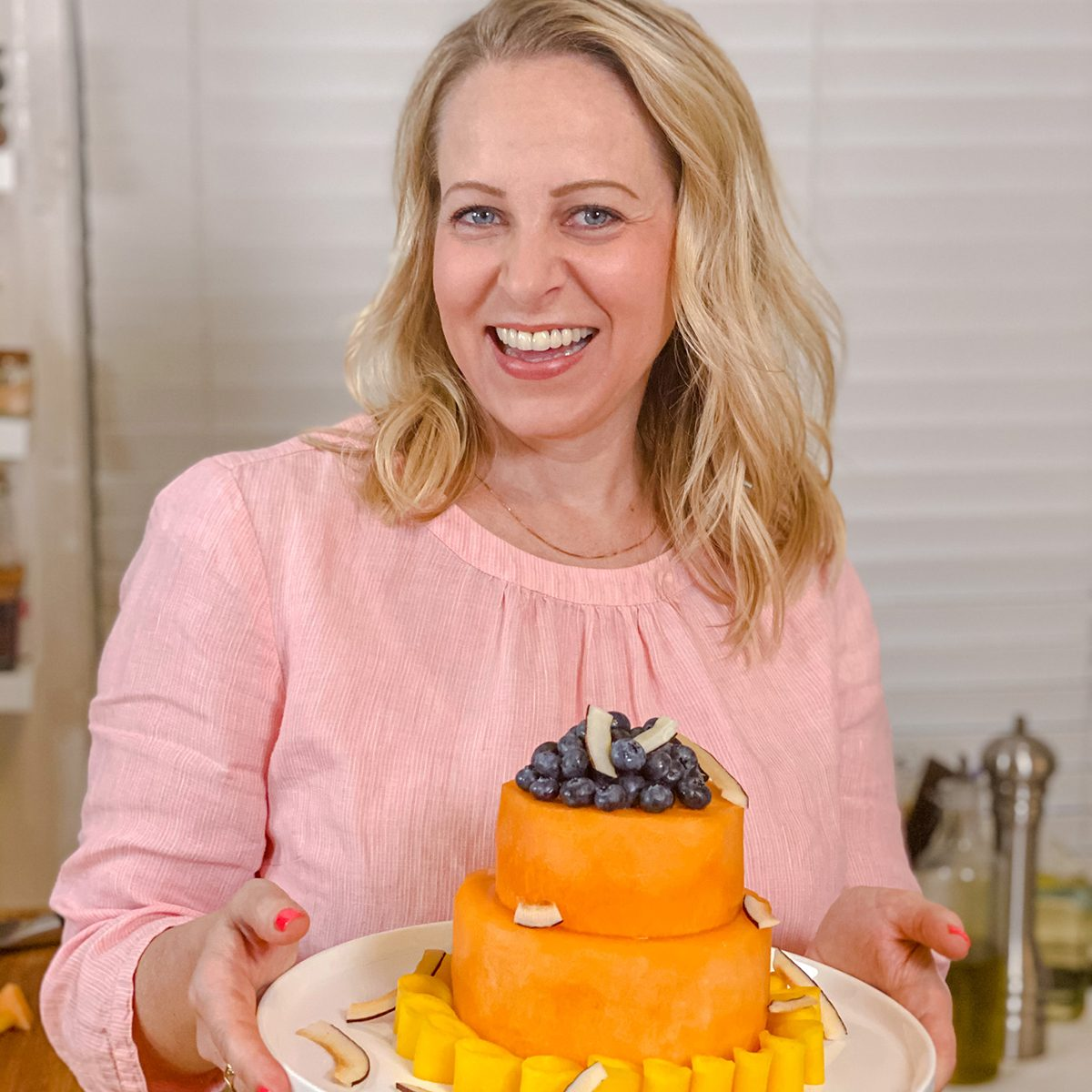 Tara Teaspoon holding her stunning melon cake