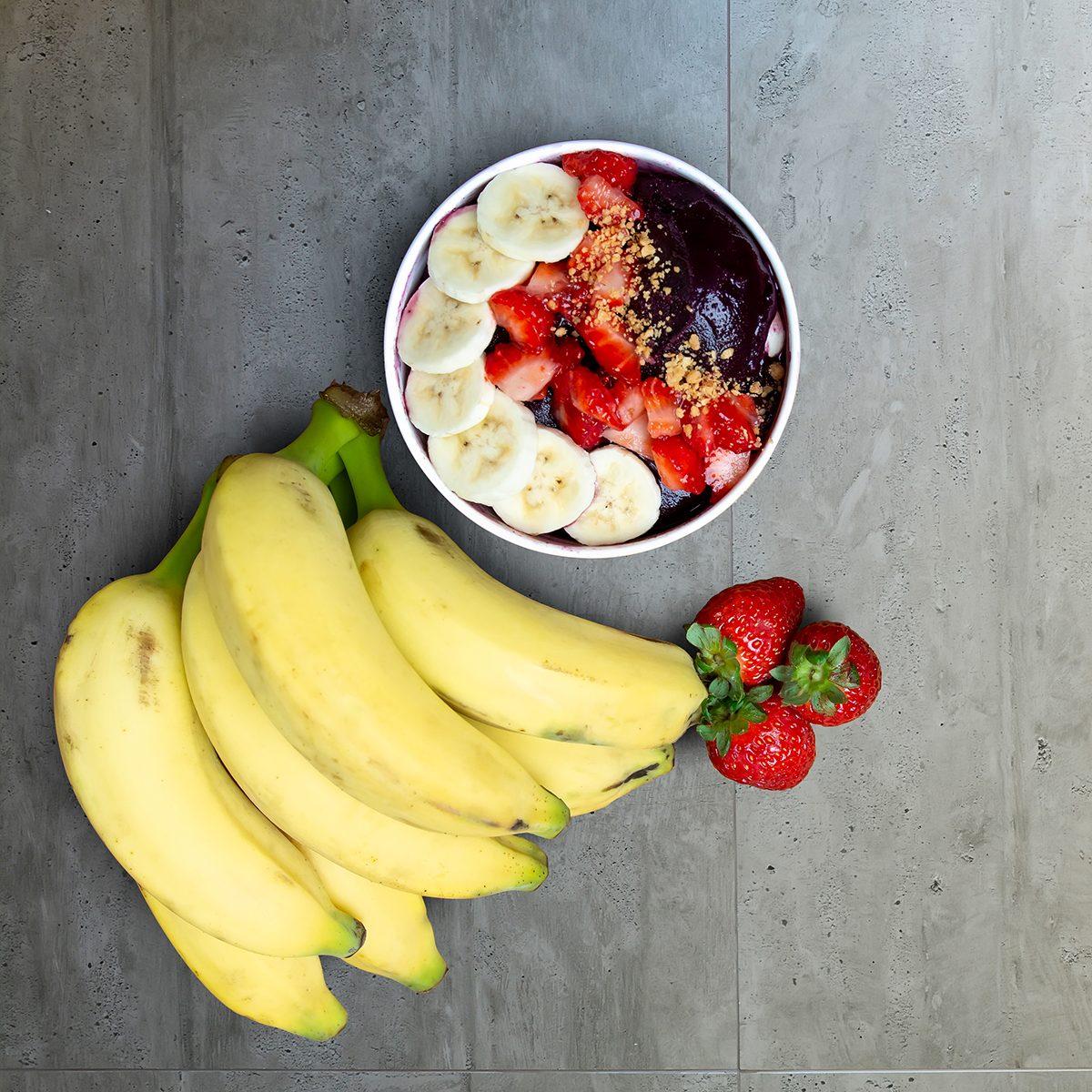 Acai Bowl With Fruits Salad Banana Mango Kiwi and Strawberry, Delicious Açaí Brazilian Cream Dessert, Açai na Tigela with copy space