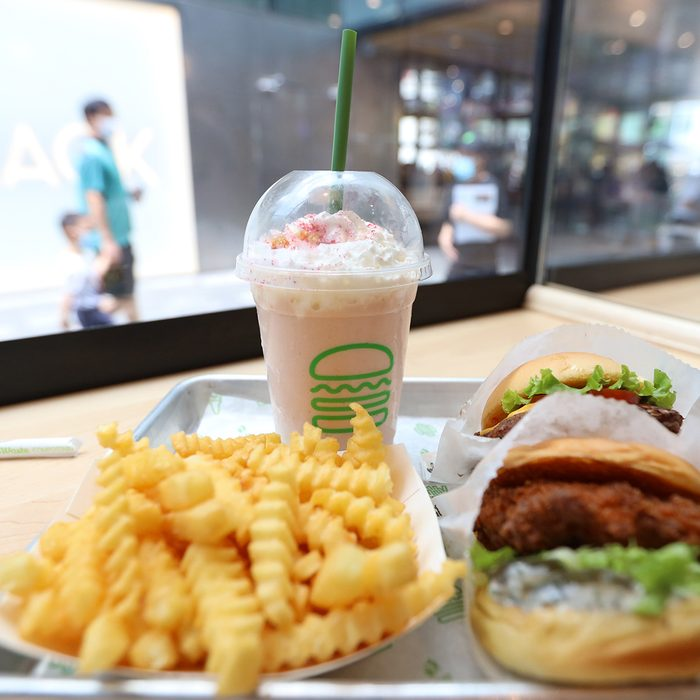 BEIJING, CHINA - AUGUST 13: An order of fast food meal (hamburger, chips and soft drink) at a Shake Shack restaurant at Sanitun on August 13, 2020 in Beijing, China. Shake Shack opened its first restaurant in Beijing on Wednesday. (Photo by VCG/VCG via Getty Images)